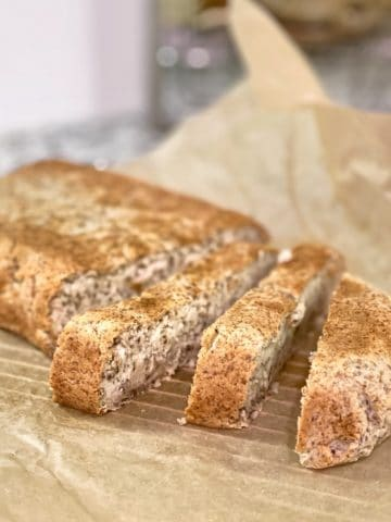 Homemade high fiber classic chia grain-free bread on parchment paper sliced