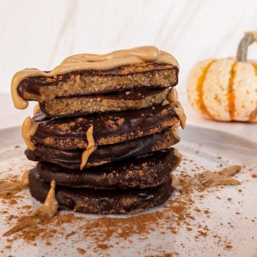 Side view of stack of chocolate pumpkins with sunbutter drizzle