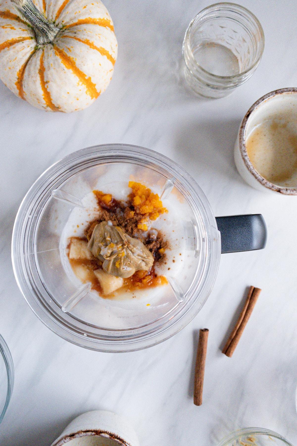 Pumpkin pie smoothie ingredients in blender