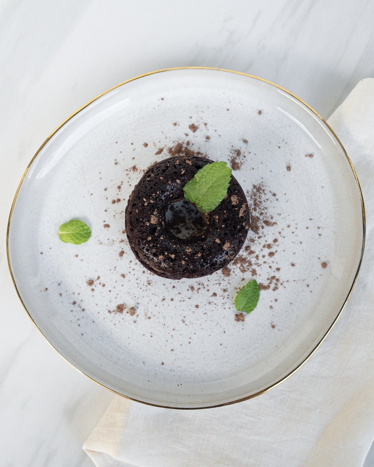 top shot of finished donut on plate with mint leaves