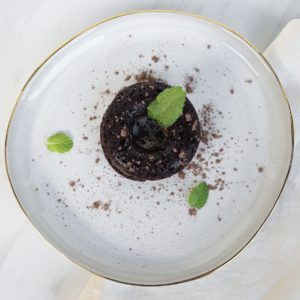 donut on plate with mint leaves