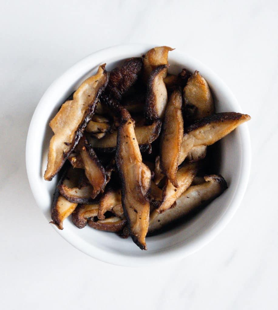 Vegan mushroom bacon in white bowl
