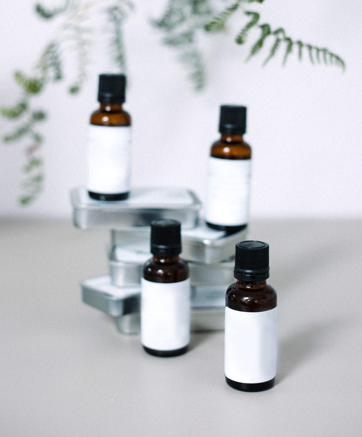 4 white essential oils bottles