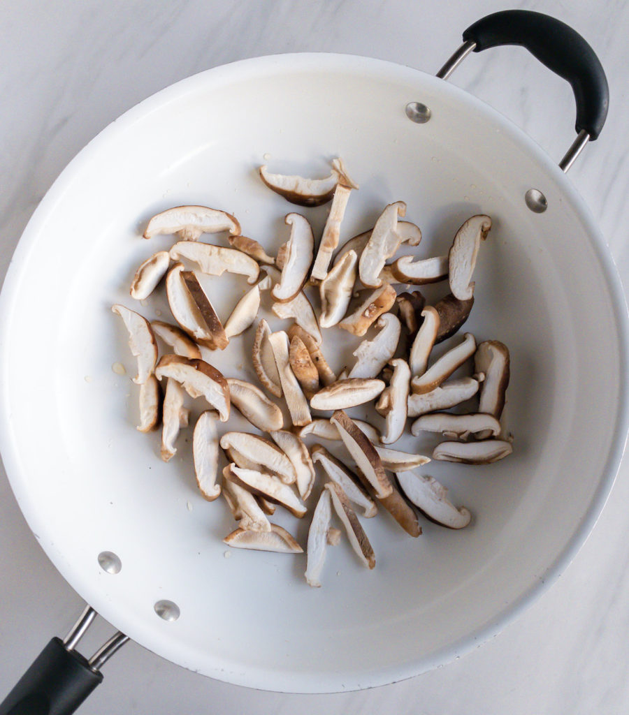 Raw mushroom slices in white pan