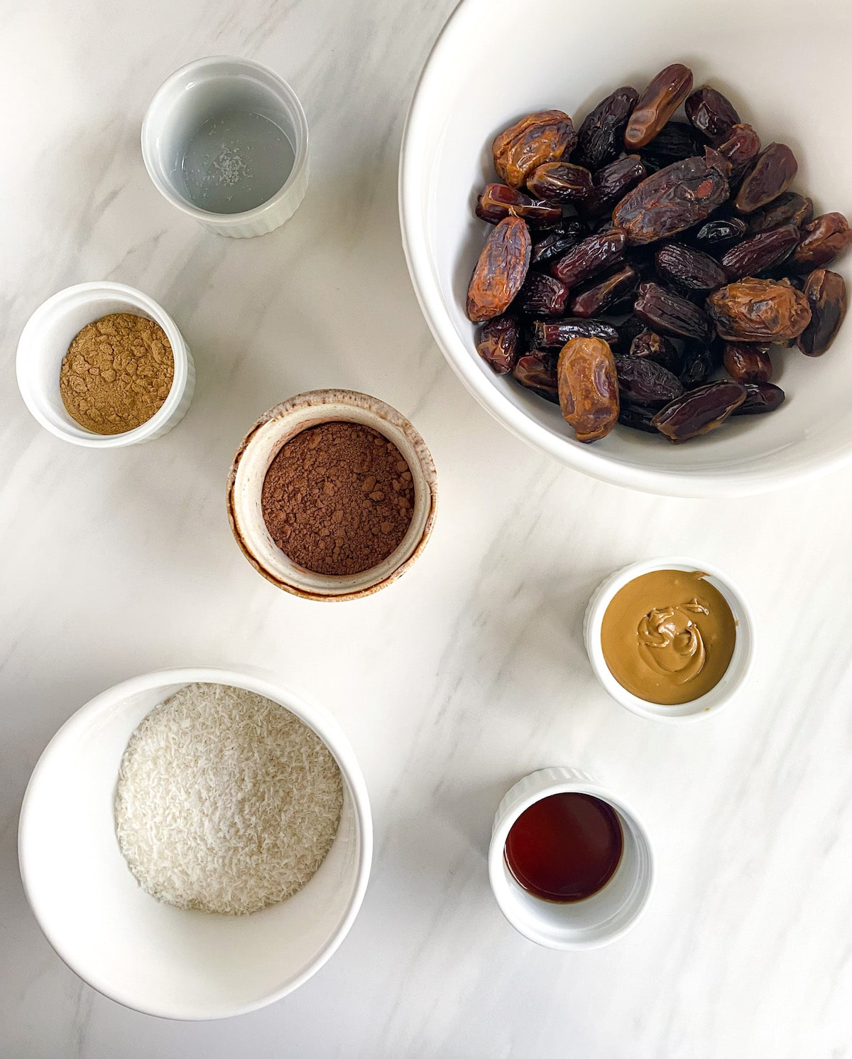 Bowls of ingredients for energy balls